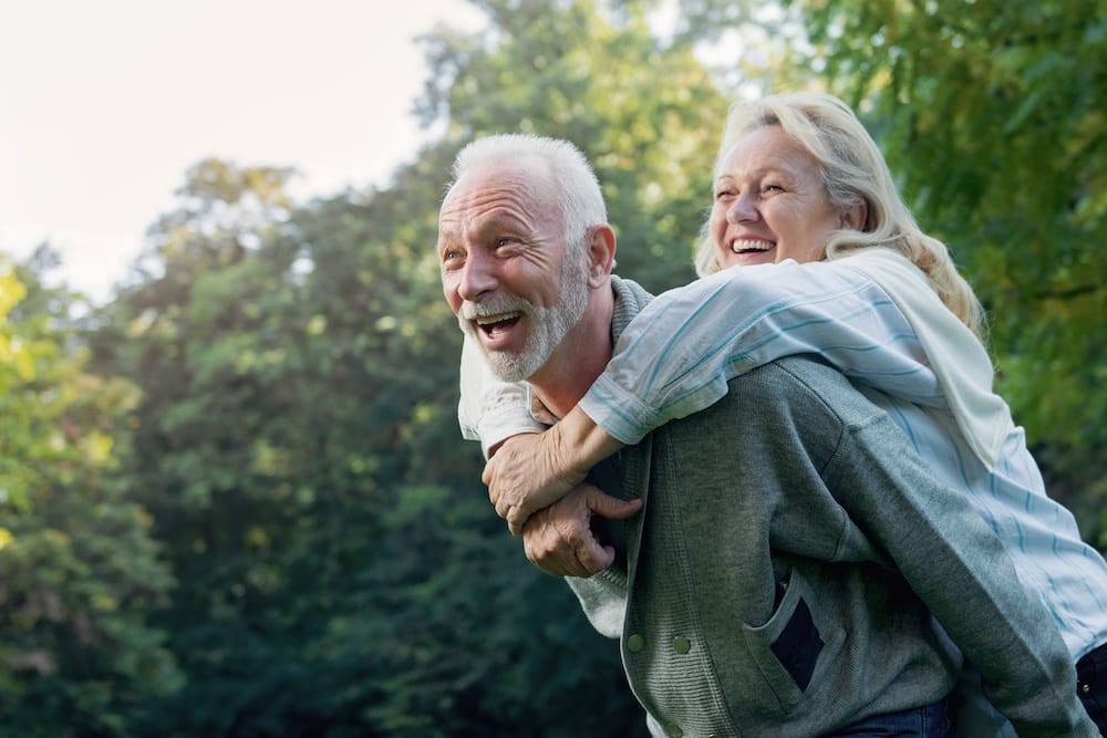Happy older couple enjoying time outside